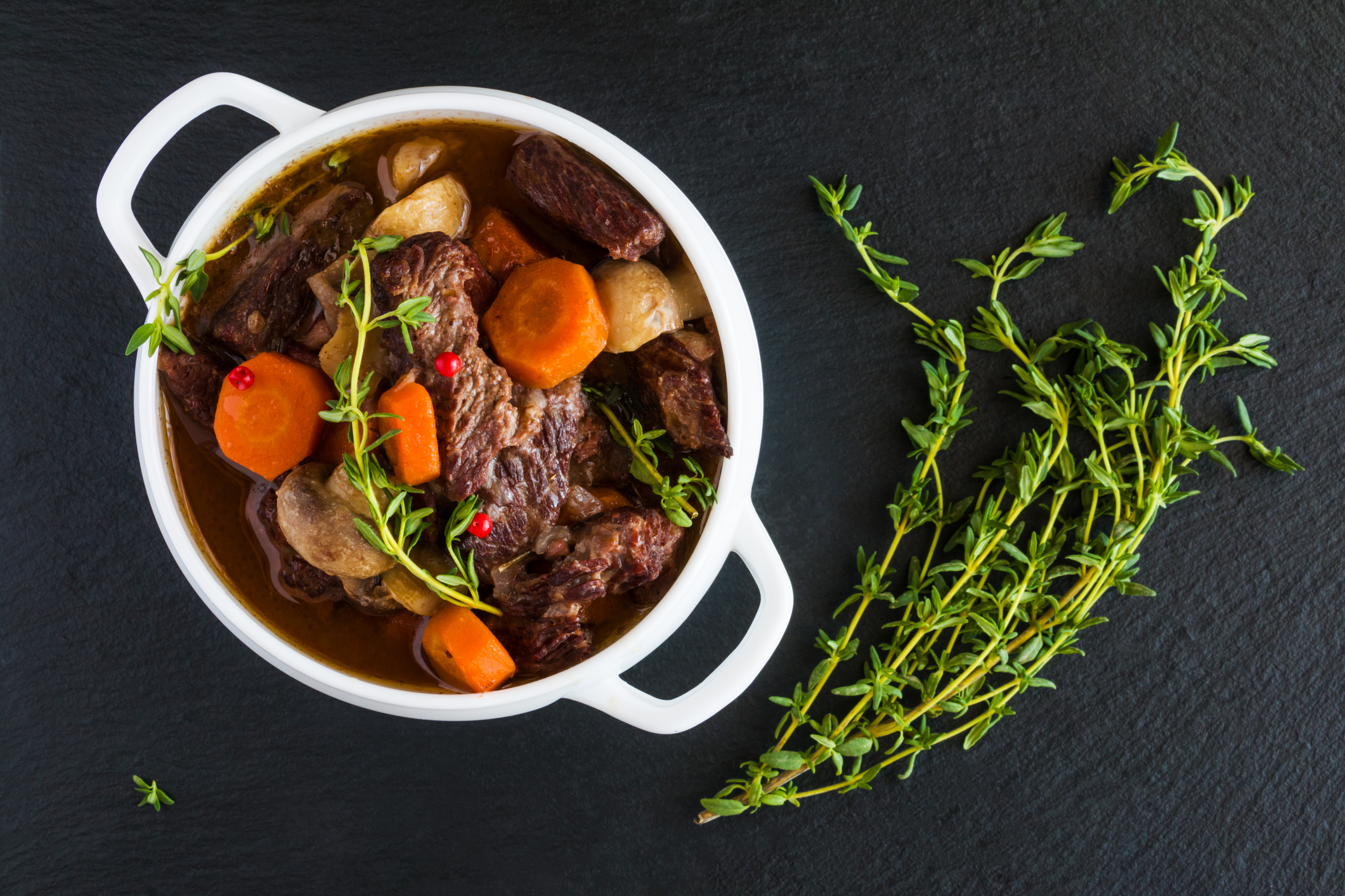 Why is slow cooked meat more tender and tasty ?